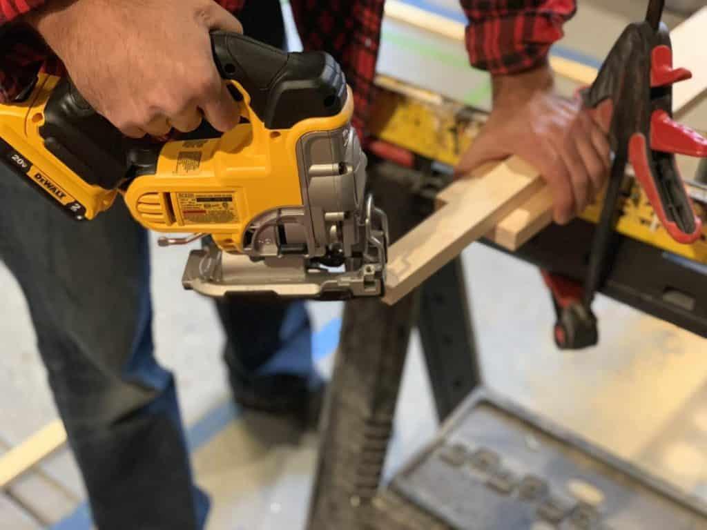 Jigsaw cutting wood.