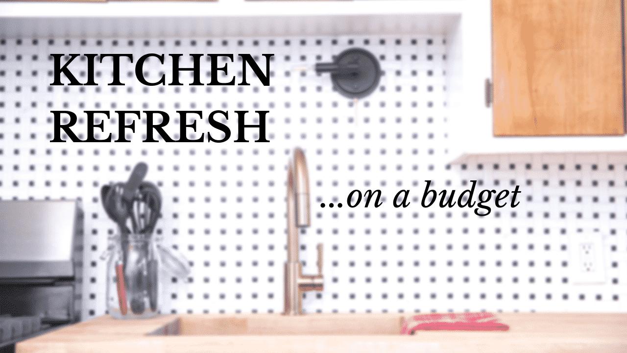Gold faucet with basket weave backsplash tile and butcher block countertop.