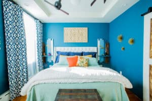 A blue well-designed bedroom
