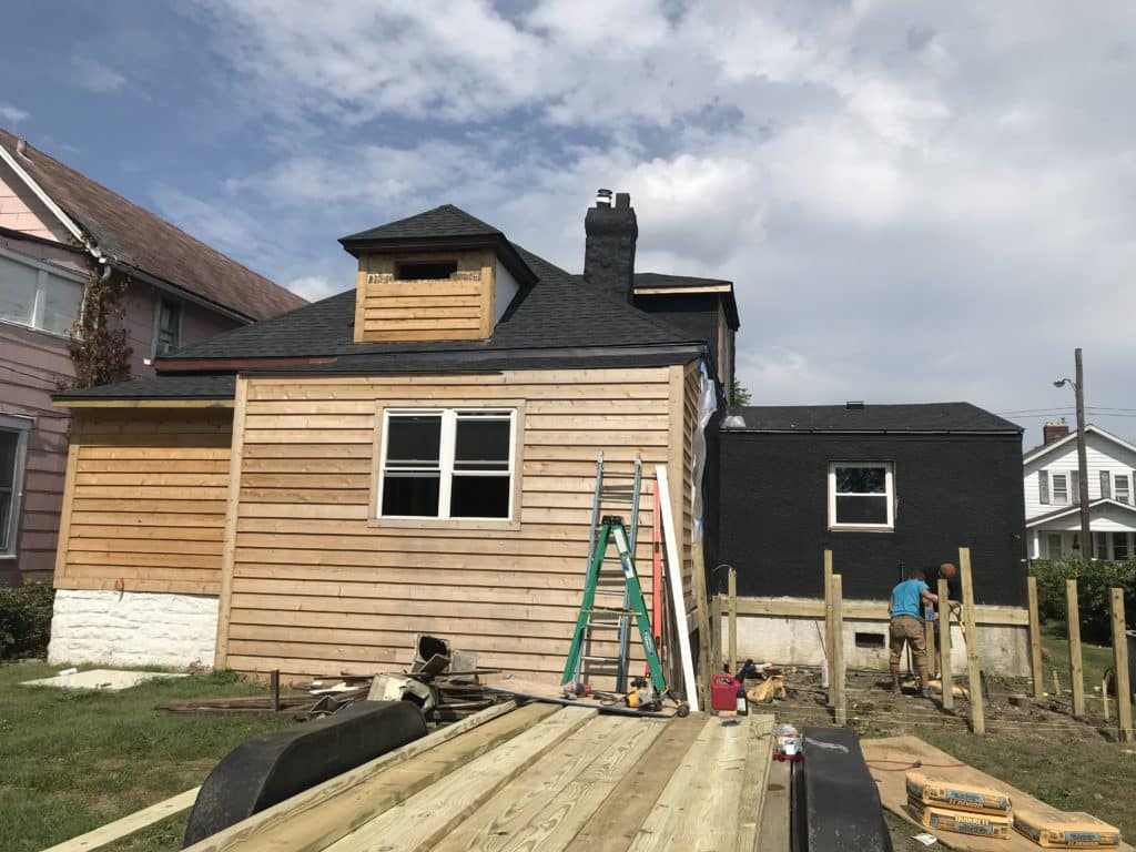 Stucco_Cedar_And_A_Painted_Black_House