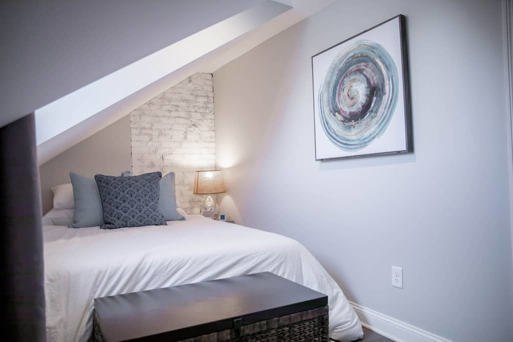 white_bedroom_blue_accents_white_painted_brick