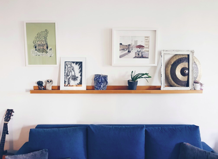 picture ledge with blue couch