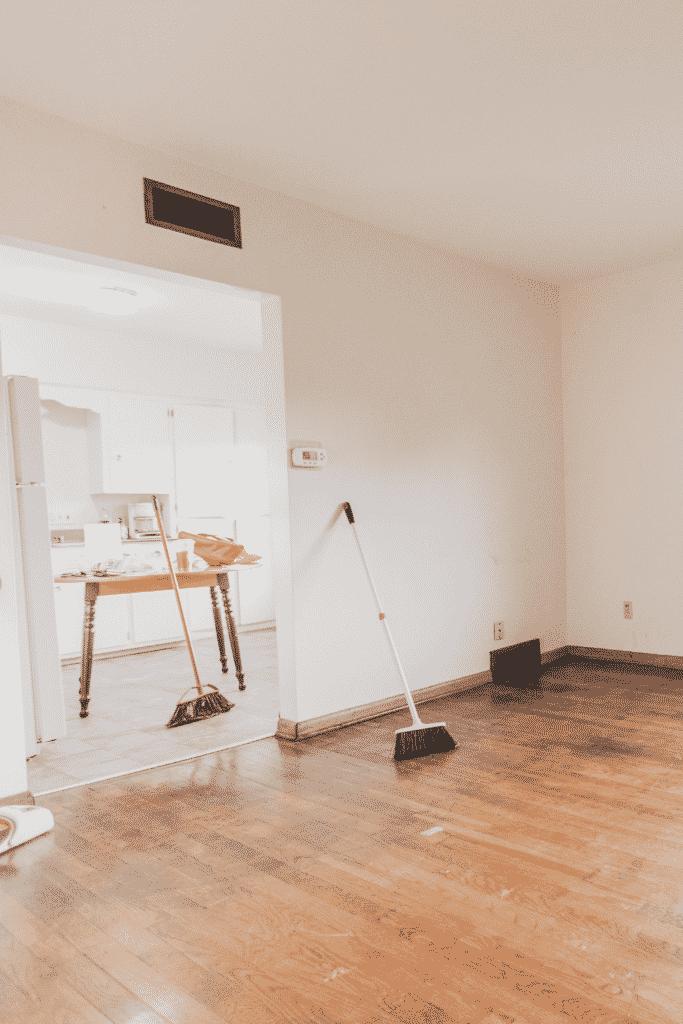brush and wooden floor
