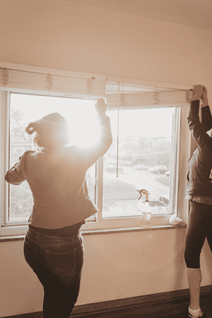 landlords fixing the blinds