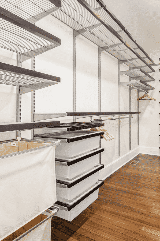 A large, empty closet with lots of shelves and storage space.