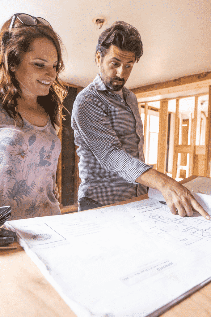a couple looking over a property survey