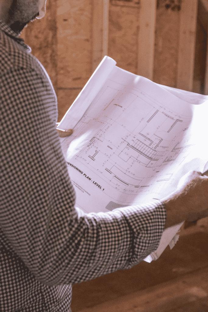 man holding a site plan