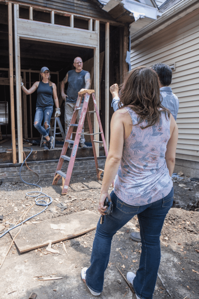 A group of people talking in a construction area.