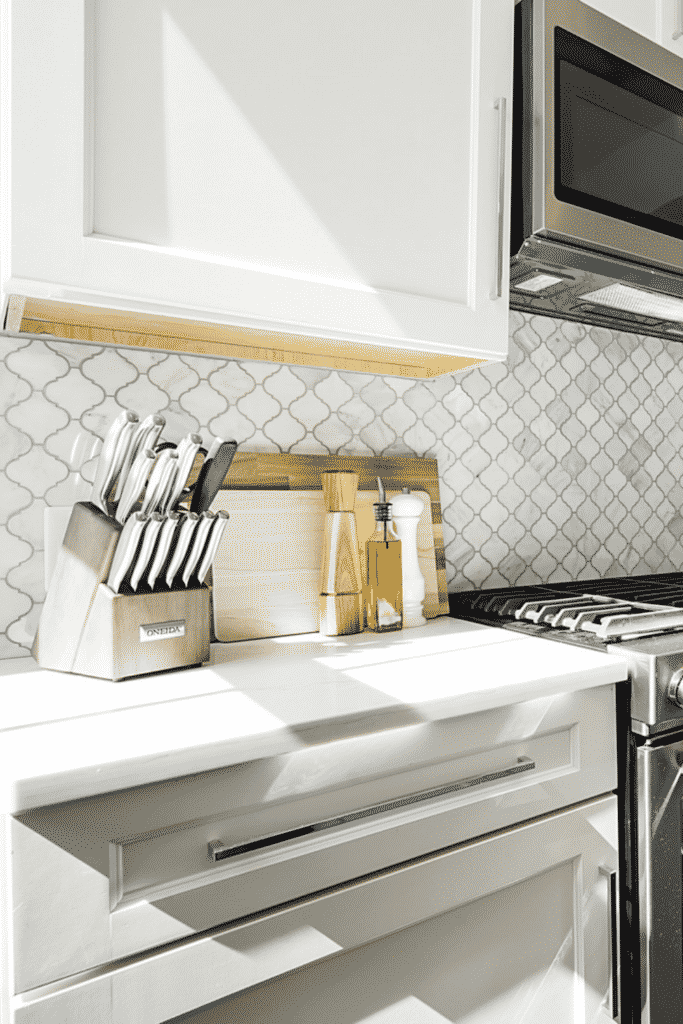 : Kitchen counter with knife block and cutting boards on it.