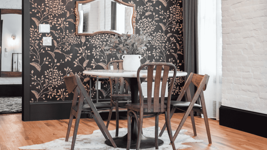 Table and four chairs with beautiful accent wall behind